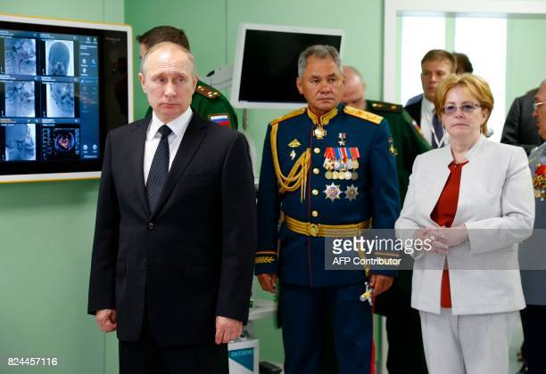 Russian President Vladimir Putin Defence Minister Sergei Shoigu and Health Minister Veronika Skvortsova visit the SM Kirov Military Medical Academy...