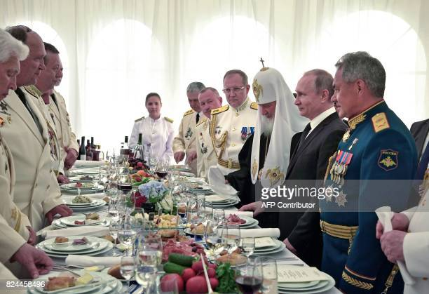 Russian President Vladimir Putin Defence Minister Sergei Shoigu Russian Patriarch Kirill of Moscow and other officials attend a reception at Russia's...