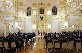 Russian President Vladimir Putin delivers a speech during a meeting with members of the country's Olympic team at the Kremlin in Moscow on July 27...