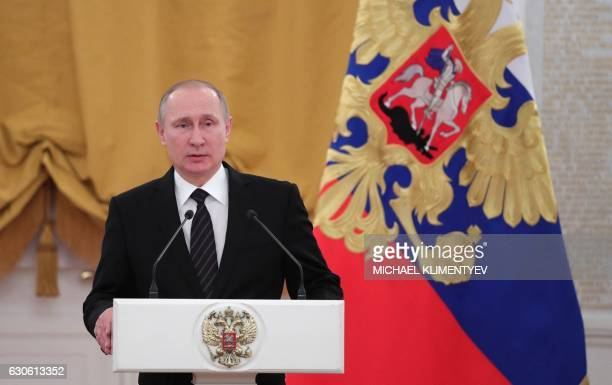 Russian President Vladimir Putin delivers a speech during a reception dedicated to the celebration of the New Year at the Kremlin in Moscow on...