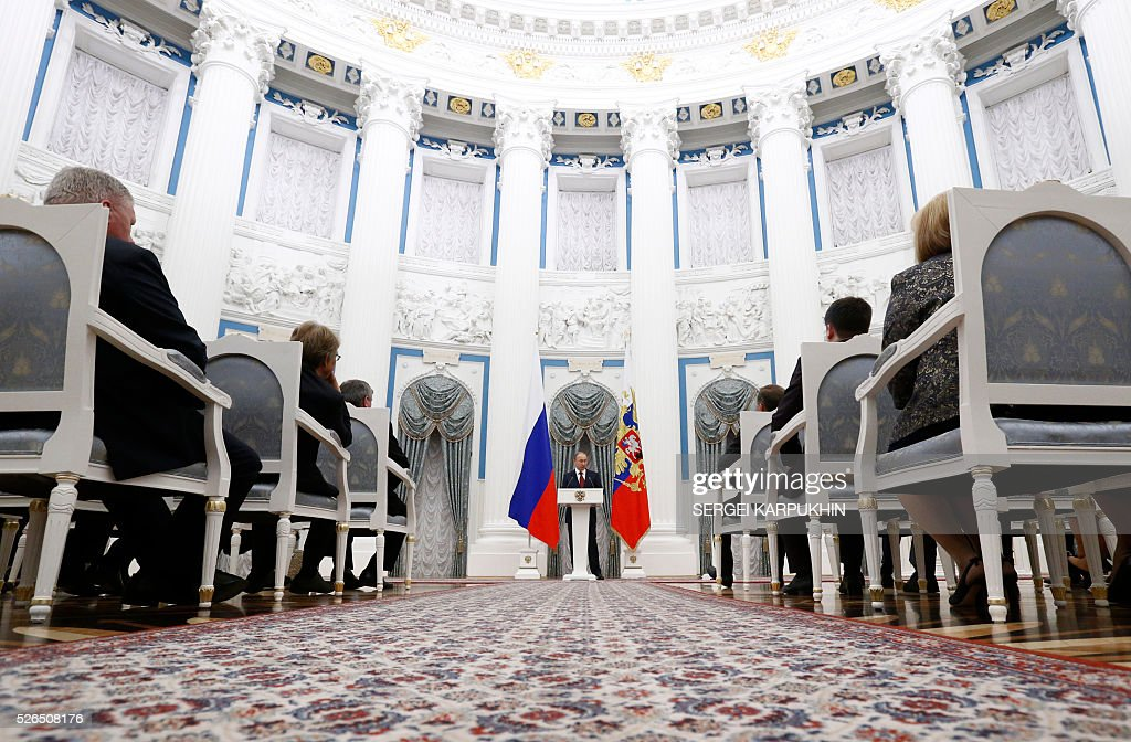 Russian President Vladimir Putin delivers a speech during a state awards ceremony at the Kremlin in Moscow on April 30, 2016. / AFP / POOL / SERGEI