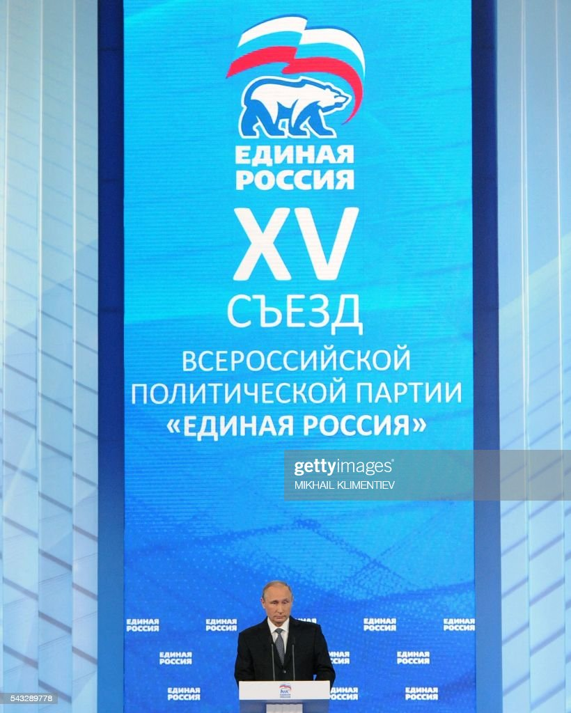 Russian President Vladimir Putin delivers a speech during the 15th Convention of the United Russia Party in Moscow on June 27, 2016. / AFP / Sputnik AND POOL / Mikhail KLIMENTIEV