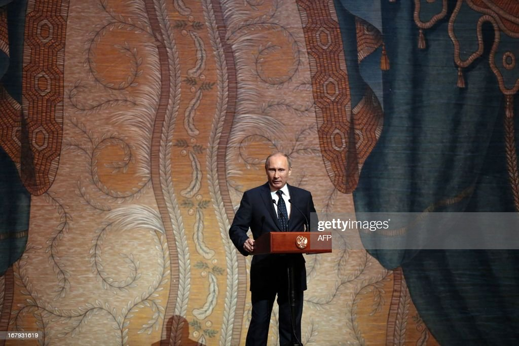 Russian President Vladimir Putin delivers a speech during the Grand gala dedicated to the opening of the new stage Mariinsky II theatre in St. Petersburg, on May 2, 2013. Russia's famous Mariinsky theatre in Saint Petersburg was to inaugurate a new ballet and opera house on May 2 in an event coinciding with the 60th birthday of its hugely ambitious and well-connected director Valery Gergiev. AFP PHOPTO / POOL / ANATOLY MALTSEV
