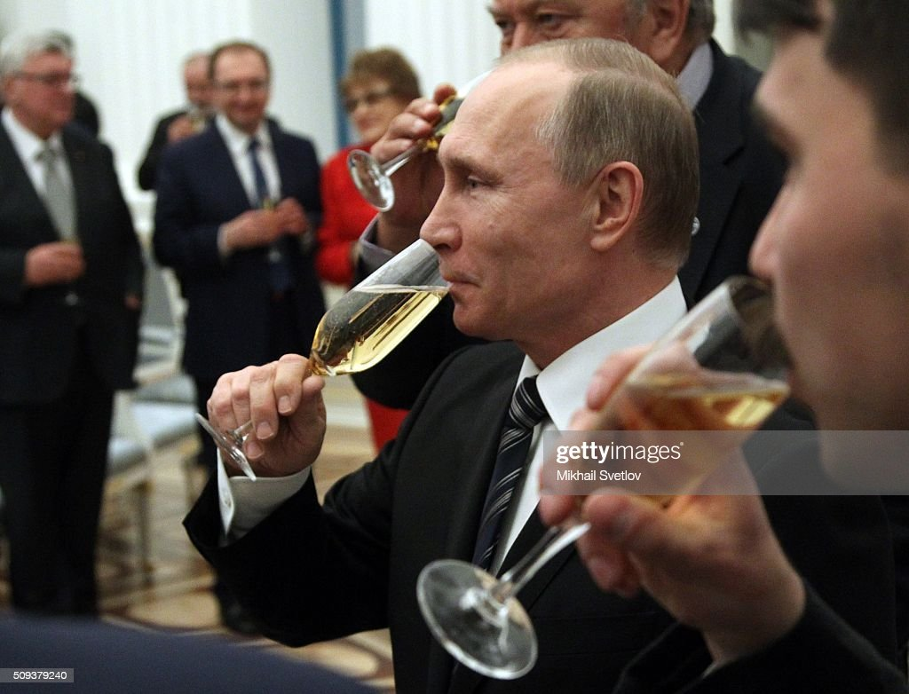 Russian President Vladimir Putin drinks champagne during an awards ceremony at the Kremlin on February 10, 2016 in Moscow, Russia. Russian President Putin awarded 3 scientists during the reception at the Krelmlin.