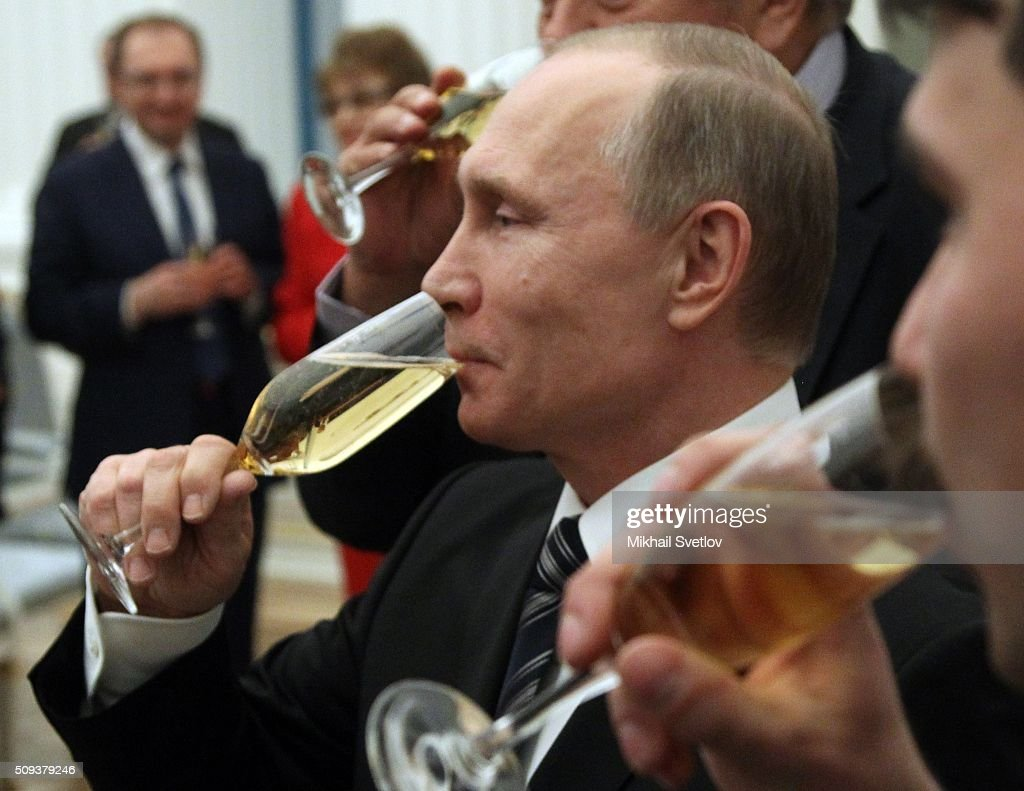 Russian President <a gi-track='captionPersonalityLinkClicked' href=/galleries/search?phrase=Vladimir+Putin&family=editorial&specificpeople=154896 ng-click='$event.stopPropagation()'>Vladimir Putin</a> drinks champagne during an awards ceremony at the Kremlin on February 10, 2016 in Moscow, Russia. Russian President Putin awarded 3 scientists during the reception at the Krelmlin.