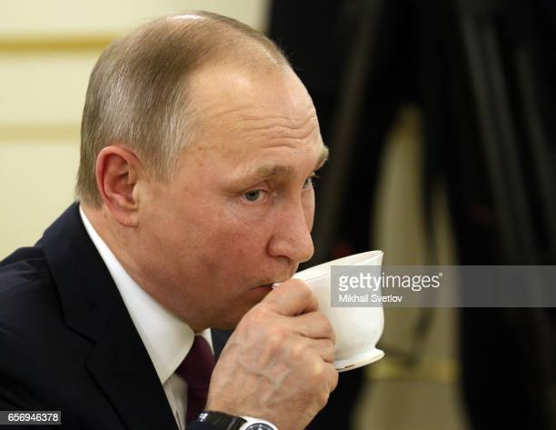 Russian President Vladimir Putin drinks tea as he visits the Maly Theatre to watch the comedy 'The Last Victim' by Russian writer Alexander Ostrovsky...