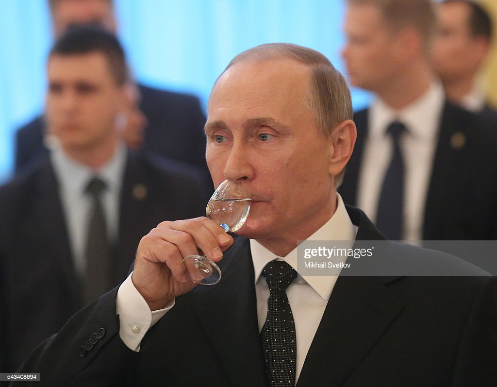 Russian President Vladimir Putin drinks vodka during the reception for graduates of military academies and universtities at the Grand Kremlin Palace on June 28, 2016 in Moscow, Russia.