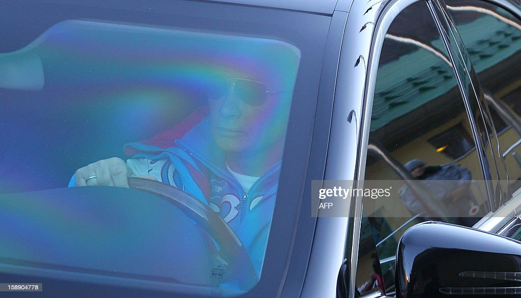Russian President Vladimir Putin drives a car during his visit to the mountain resort in Krasnaya Polyana outside the Russian Black Sea resort of Sochi on January 3, 2013.