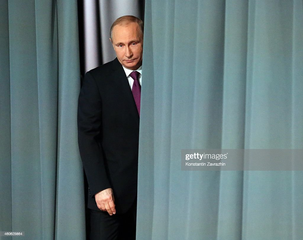 Russian President <a gi-track='captionPersonalityLinkClicked' href=/galleries/search?phrase=Vladimir+Putin&family=editorial&specificpeople=154896 ng-click='$event.stopPropagation()'>Vladimir Putin</a> during an annual press conference on December 18, 2014 in Moscow, Russia. The national address comes amid growing concerns of a financial crisis as the price of crude oil and Western sanctions against Russia over the Ukraine crisis are being blamed for plunging the rouble to a record low against dollar and euro.