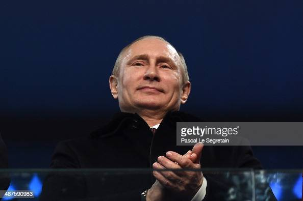 Russian President Vladimir Putin enjoys the atmosphere during the Opening Ceremony of the Sochi 2014 Winter Olympics at Fisht Olympic Stadium on...