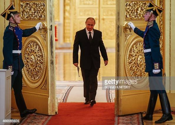 Russian President Vladimir Putin enters a hall before a meeting of the Victory Organizing Committee at the Kremlin in Moscow on March 17 2015 The...