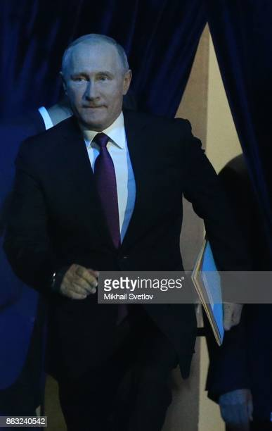Russian President Vladimir Putin enters the hall during his meeting with Valdai Discussion Club members in Sochi Russia October 2017 Photo by Mikhail...