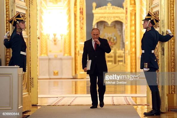 Russian President Vladimir Putin enters the hall to deliver his annual speech to the Federal Assembly at Grand Kremlin Palace on December 2016 in...