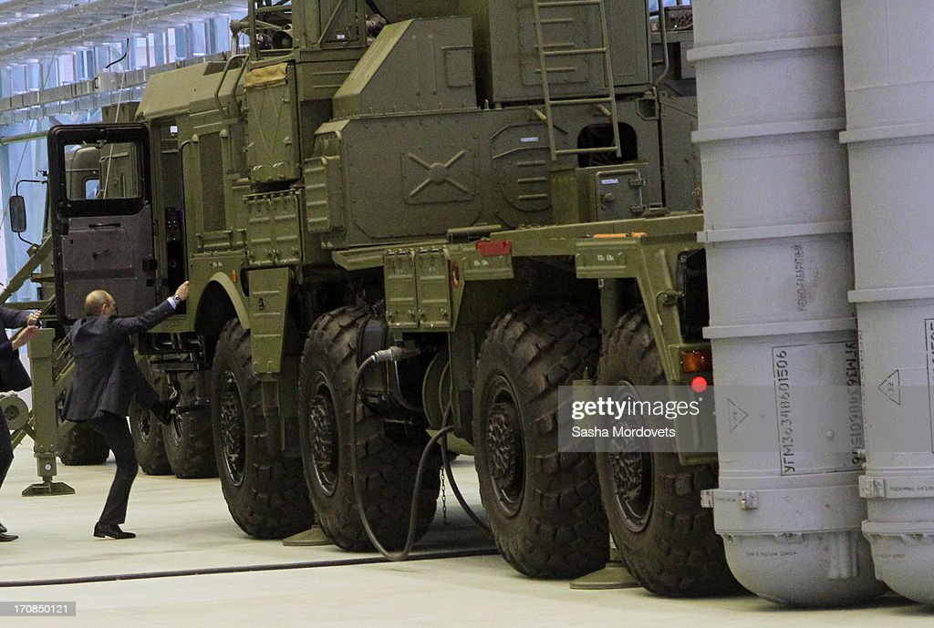Russian President Vladimir Putin (C) examines a new Surface-to-air missile complex Vityaz, also known as MASM of MRADS, as he visits the Obukhov state plant on June 19, 2013 in in Saint Petersburg, Russia. Putin held a meeting at the plant on the development and implementation of military services and equipment.