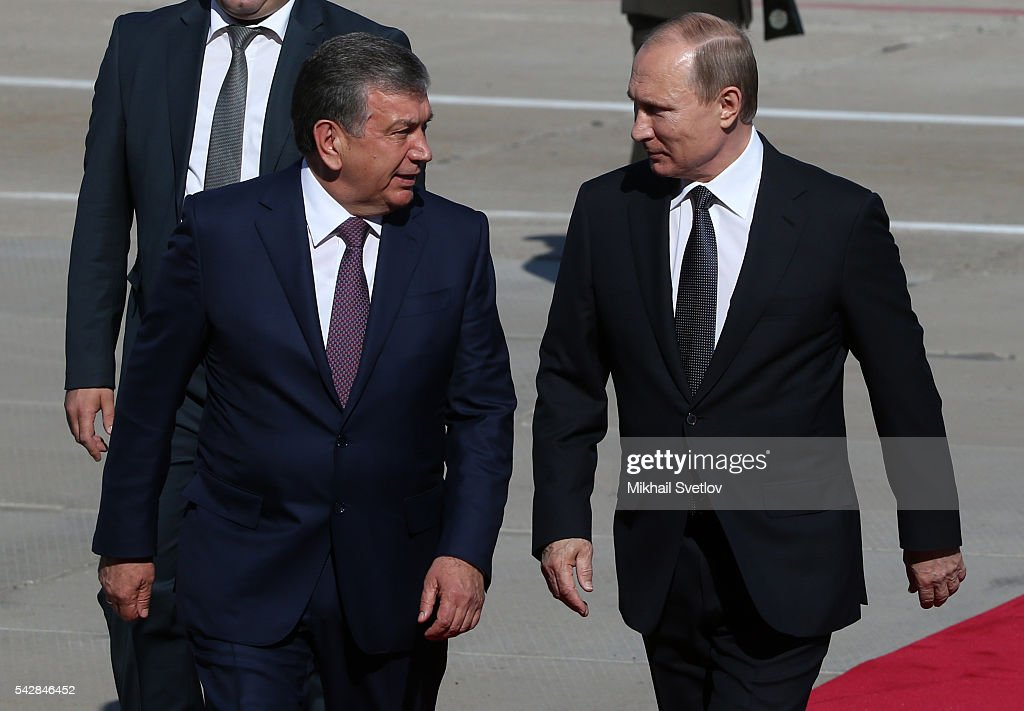 Russian President <a gi-track='captionPersonalityLinkClicked' href=/galleries/search?phrase=Vladimir+Putin&family=editorial&specificpeople=154896 ng-click='$event.stopPropagation()'>Vladimir Putin</a> (R) followed by Uzbek Prime Minister Shavkat Mirziyoyev (L) arrive to the Tashkent International Airport in Tashkent, Uzbekistan, June, 23, 2016. Putin has arrived to Uzbekistan to attend the Shanghai Cooperation Organisation (SCO) Summit.