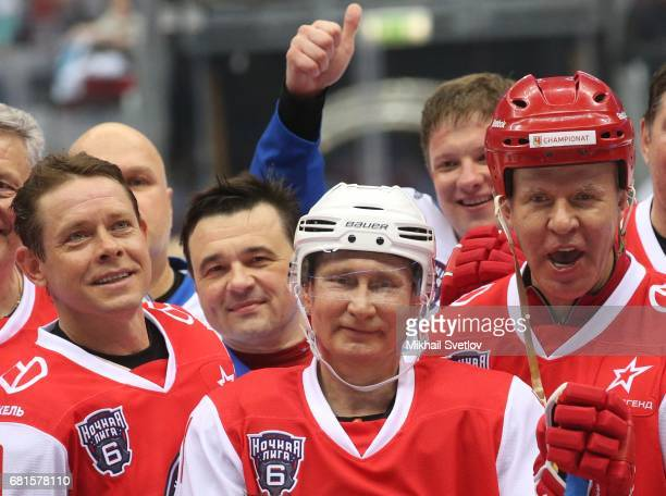Russian President Vladimir Putin former NHL players Slava Fetisov and Pavel Bure attend a gala match of the Night Hockey League teams at the Bolshoy...