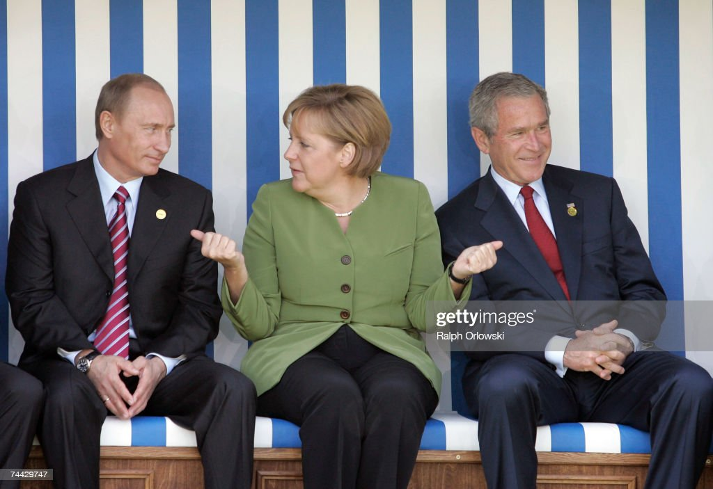 Russian President <a gi-track='captionPersonalityLinkClicked' href=/galleries/search?phrase=Vladimir+Putin&family=editorial&specificpeople=154896 ng-click='$event.stopPropagation()'>Vladimir Putin</a>, German Chancellor <a gi-track='captionPersonalityLinkClicked' href=/galleries/search?phrase=Angela+Merkel&family=editorial&specificpeople=202161 ng-click='$event.stopPropagation()'>Angela Merkel</a> and U.S. President George W. Bush chat as they sit in a beach chair during the first day of talks with other leaders of G8 industrialized nations at the G8 summit June 7, 2007 in Heiligendamm, Germany. The three-day summit runs from June 6-8 with talks aimed at combating climate change topping the agenda.