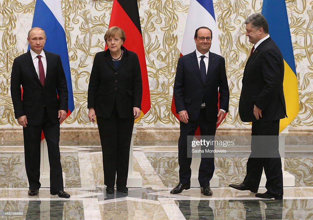 Russian President Vladimir Putin German Chancellor Angela Merkel French President Francois Hollande and Ukrainian President Alexander Lukashenko pose...
