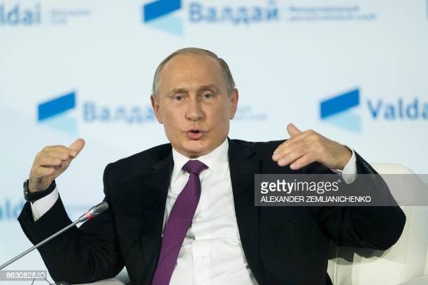 Russian President Vladimir Putin gestures as he speaks during the annual Valdai club conference of international experts in Sochi on October 19 2017...