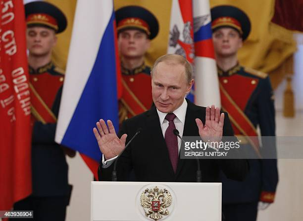 Russian President Vladimir Putin gestures during a ceremony of presenting jubilee medals in honor of the 70th anniversary of the victory in the World...