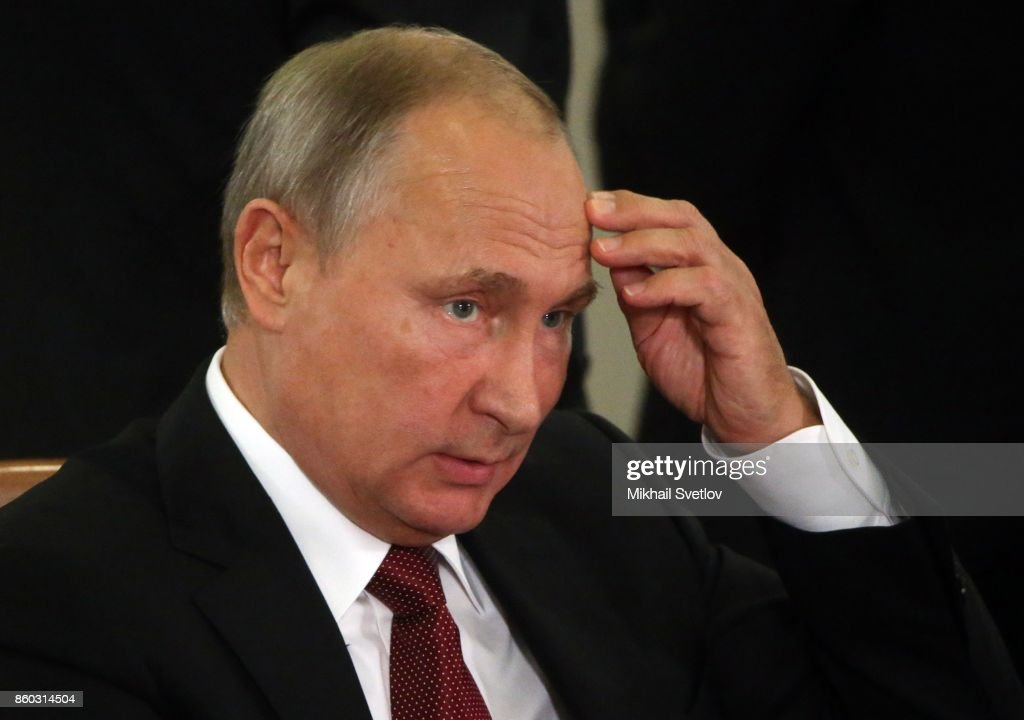 Russian President Vladimir Putin gestures during the Summit of CIS October 12, 2017 in Sochi, Russia. Leaders of ex-Soviet states have gathered in Sochi for the CIS and Eurasian Economic Orgahisation. Photo by Mikhail Svetlov/Getty Images)