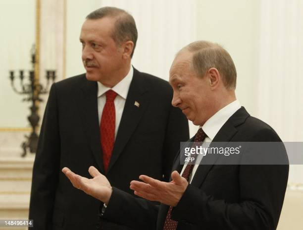 Russian President Vladimir Putin gestures next to Turkish Prime Minister Recep Tayyip Erdogan during their meeting to discuss differences on Syria as...