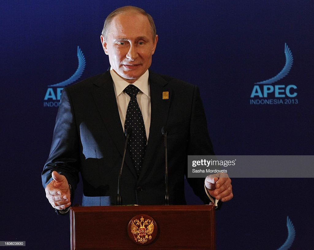 Russian President <a gi-track='captionPersonalityLinkClicked' href=/galleries/search?phrase=Vladimir+Putin&family=editorial&specificpeople=154896 ng-click='$event.stopPropagation()'>Vladimir Putin</a> gives a press conference at the APEC Leaders Summit on October 8, 2013 in Denpadsar, Bali, Indonesia. US President Barack Obama will not be attending the annual gathering due to the US government shutdown, seen as potentially weakening the United States attempts to push for an ambitious 12 nation trade pact.