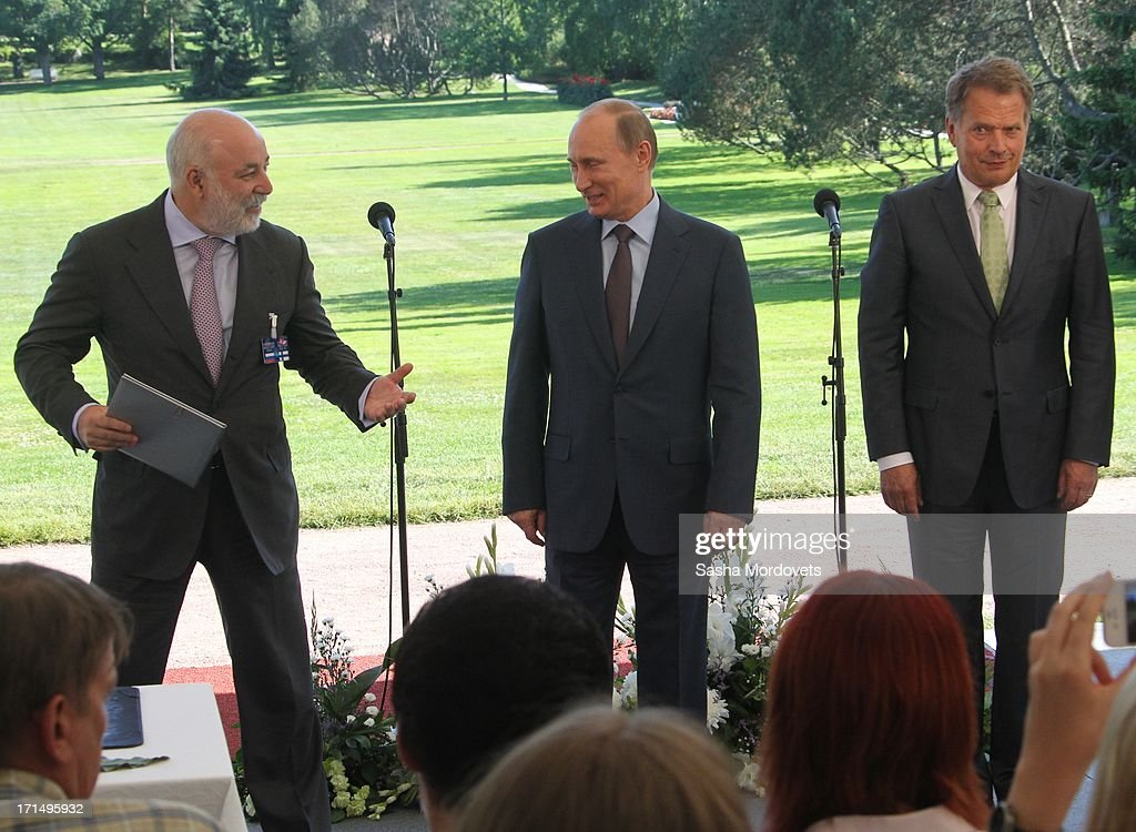 Russian President Vladimir Putin (C) gives a press conference with Finland President Sauli Niinisto (R) and and businessman Viktor Vekselberg (L) at Niinisto's summer residence Kultaranta June 25, 2013 in Naantali, Finland. Putin is having a one-day visit to Finland.
