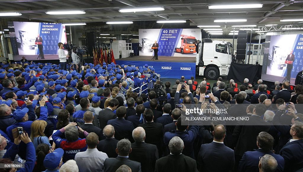 Russian President Vladimir Putin (on stage) gives a speech at a ceremony marking 40 years since the launch of the production of KAMAZ trucks at the KamAZ vehicle plant in Naberezhnye Chelny, in the Russia's region of Tatarstan, about 700 kilometers (450 miles) east of Moscow, on February 12, 2016. AFP PHOTO / POOL / ALEXANDER ZEMLIANICHENKO / AFP / POOL / ALEXANDER ZEMLIANICHENKO