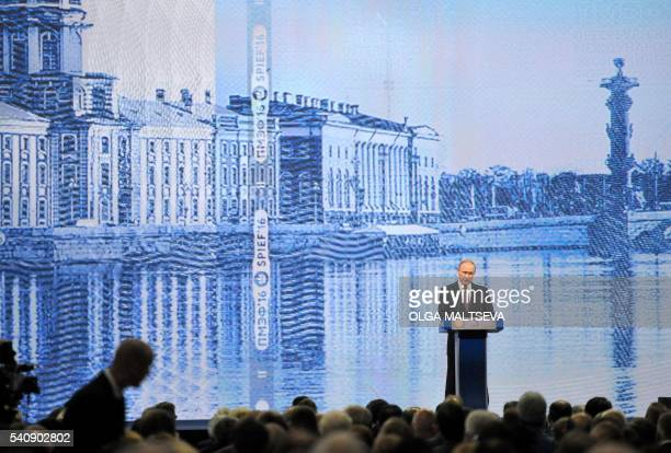 Russian President Vladimir Putin gives a speech at a session of the St Petersburg International Economic Forum in Saint Petersburg on June 17 2016 /...