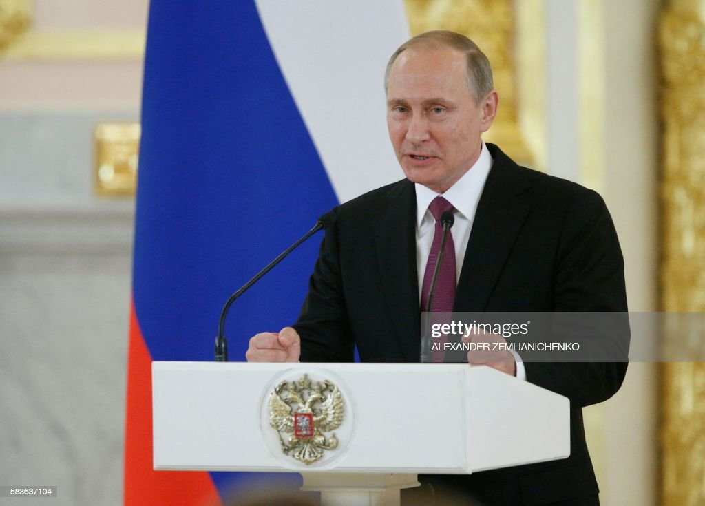 Russian President Vladimir Putin gives a speech during a meeting with members of the country's Olympic team at the Kremlin in Moscow on July 27 2016...