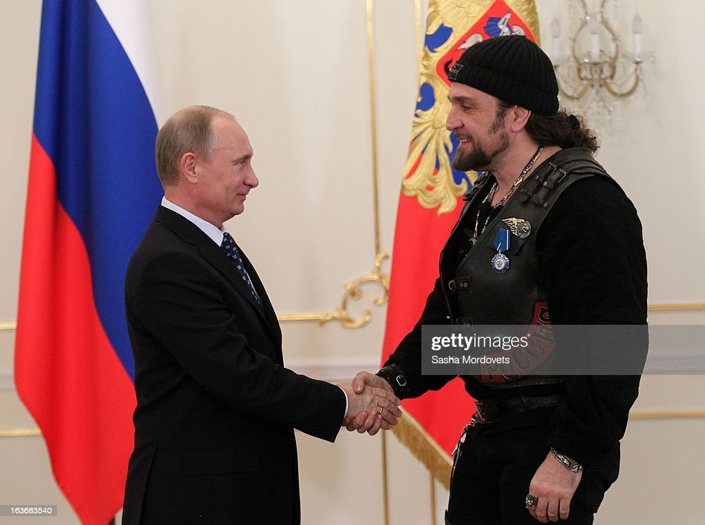 Russian President <a gi-track='captionPersonalityLinkClicked' href=/galleries/search?phrase=Vladimir+Putin&family=editorial&specificpeople=154896 ng-click='$event.stopPropagation()'>Vladimir Putin</a> (L) gives the Order of Honour to Night Wolves biker club leader Alexander Zaldostanov (nicknamed 'Surgeon') during a ceremony with the Russian Military Historical Society on March 14, 2013 in Moscow, Russia. Putin presented state decorations to those involved in patriotic and military history.
