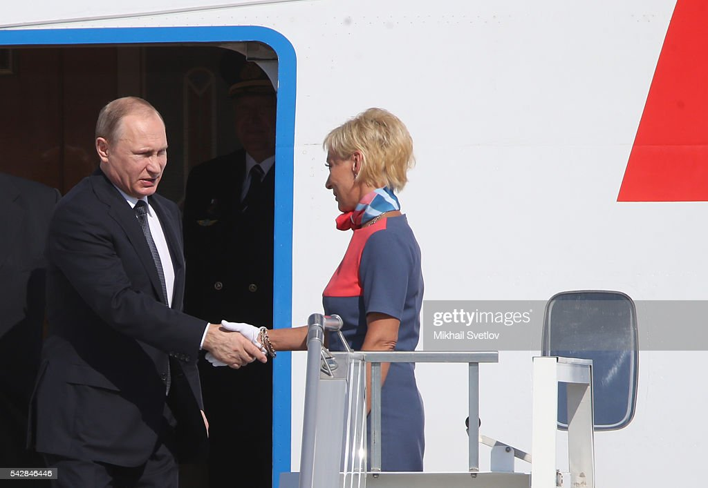 Russian President <a gi-track='captionPersonalityLinkClicked' href=/galleries/search?phrase=Vladimir+Putin&family=editorial&specificpeople=154896 ng-click='$event.stopPropagation()'>Vladimir Putin</a> (L) greets a stewardess as he arrives to the Tashkent International Airport in Tashkent, Uzbekistan, June, 23, 2016. Putin has arrived to Uzbekistan to attend the Shanghai Cooperation Organisation (SCO) Summit.