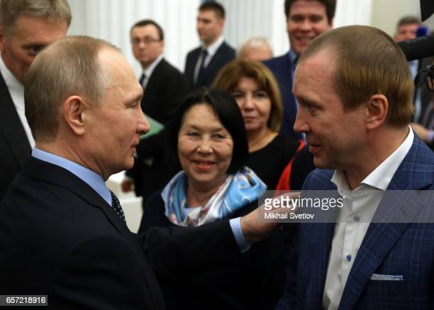 Russian President Vladimir Putin greets actor and theatre director Yevgeny Mironov during the awards ceremony at the Kremlim on March 2017 in Moscow...