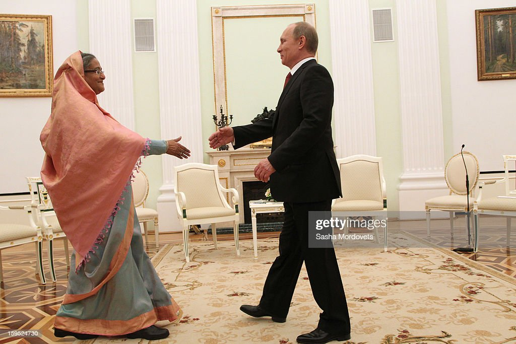 Russian President Vladimir Putin (R) greets Bangladesh's Prime Minister Sheikh Hasina (L) during their meeting at the Kremlin, on January 15, 2013 in Moscow, Russia. During Hasina's three day state visit to Russia she will sign defence and nuclear energy agreements, including a deal to help fund construction of Bangladesh's first nuclear power plant.