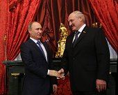 Russian President Vladimir Putin greets Belarussian President Alexander Lukashenko prior to the Summit of Collective Security Treaty Organisation in...