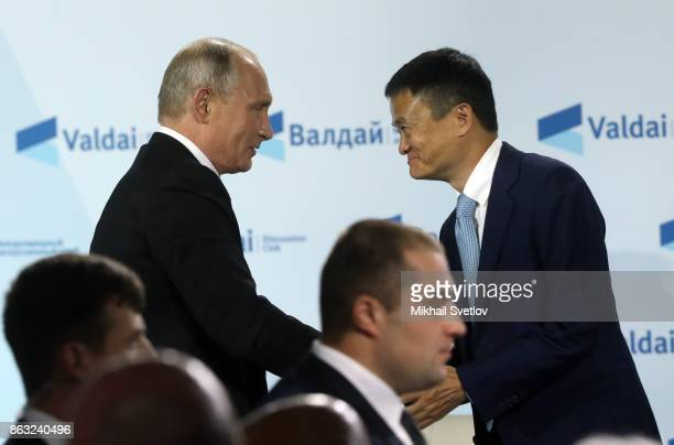 Russian President Vladimir Putin greets Chinese ecommerce giant Alibaba Group's Chairman Jack Ma during a meeting with Valdai Discussion Club members...