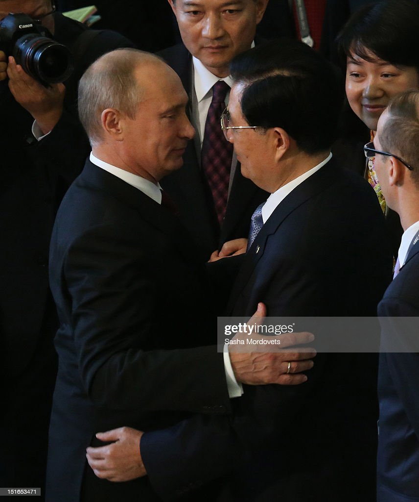 Russian President Vladimir Putin greets Chinese President Hu Jintao at the Asian Pacific Economic Cooperation (APEC) Summit, on September 9, 2012 in Vladivostok, Russia. Leaders of APEC countries are gathered at Russky Island in Vladivostok to seek freer trade among member nations.