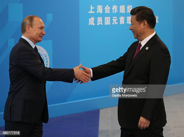 Russian President Vladimir Putin greets Chinese President Xi Jinping during the Shanghai Cooperation Organisation Summit on July 10 2015 in Ufa...
