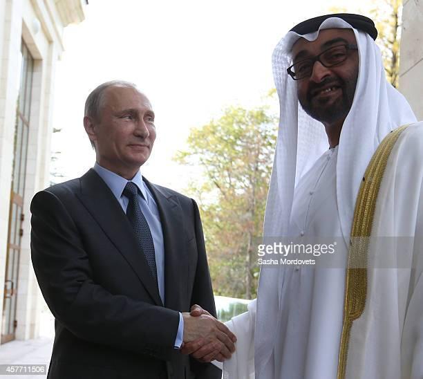 Russian President Vladimir Putin greets Crown Prince of Abu Dhabi Sheikh Abdullah bin Zayed alNahayn during their meeting on October 23 2014 in Sochi...