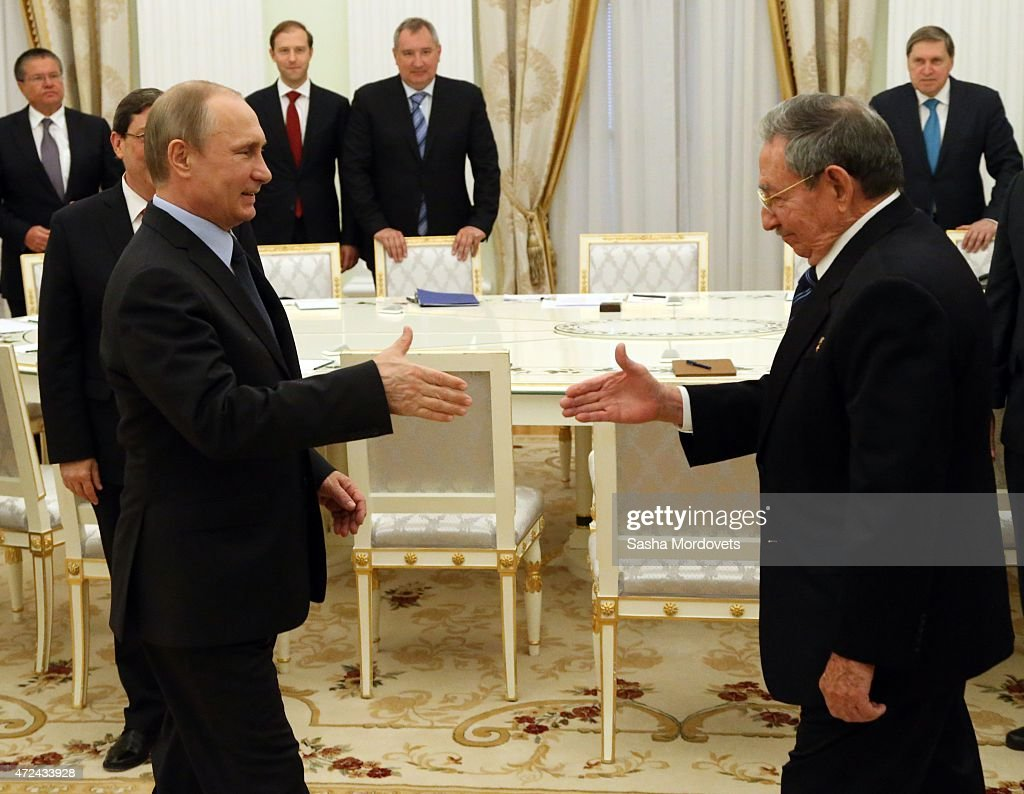 Russian President <a gi-track='captionPersonalityLinkClicked' href=/galleries/search?phrase=Vladimir+Putin&family=editorial&specificpeople=154896 ng-click='$event.stopPropagation()'>Vladimir Putin</a> (L) greets Cuban President <a gi-track='captionPersonalityLinkClicked' href=/galleries/search?phrase=Raul+Castro&family=editorial&specificpeople=239452 ng-click='$event.stopPropagation()'>Raul Castro</a> (R) in the Kremlin May 7, 2015 in Moscow, Russia. Castro has arrived in Moscow to attend in the celebrations of the Victory Day and to watch a Red Square Military Parade honour the 70-th Anniversary of the Victory over Nazis.