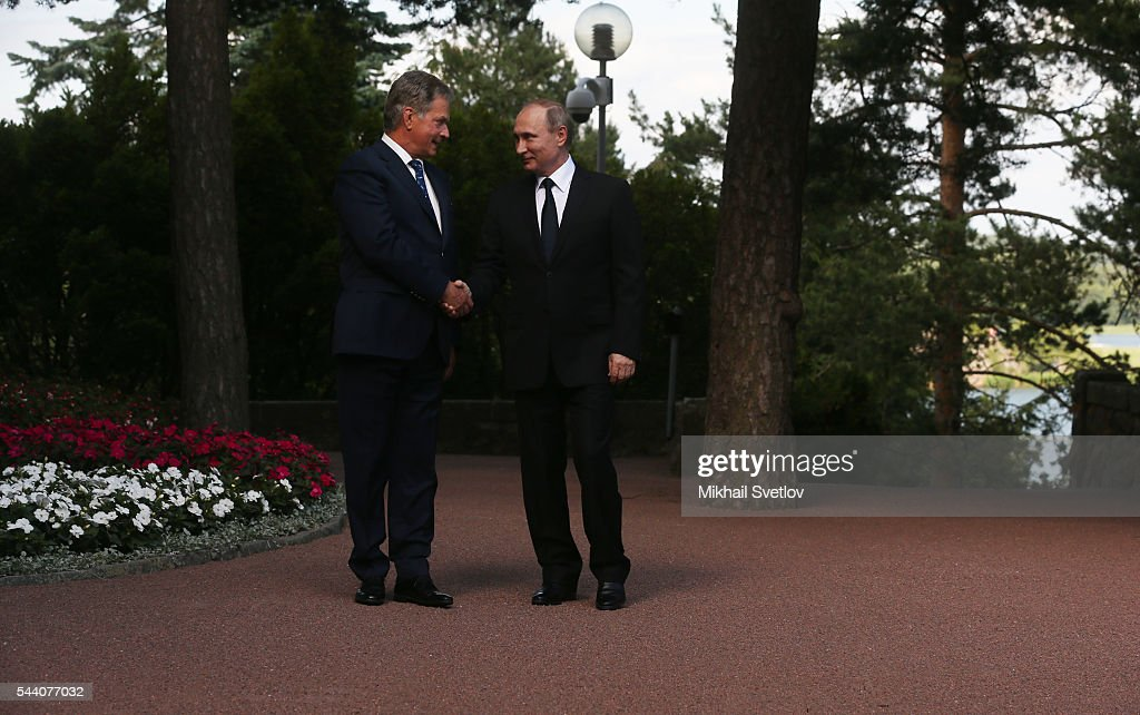 Russian President Vladimir Putin (R) greets Finland's President Sauli Niinisto at the Kultaranta residence on July 1, 2016 in Naantali, Finland. Putin is on a one-day visit to Finland.