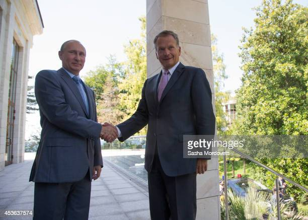 Russian President Vladimir Putin greets Finnish President Sauli Niinisto in Bocharov Ruchey state residence on August 15 2014 in Sochi Russia...