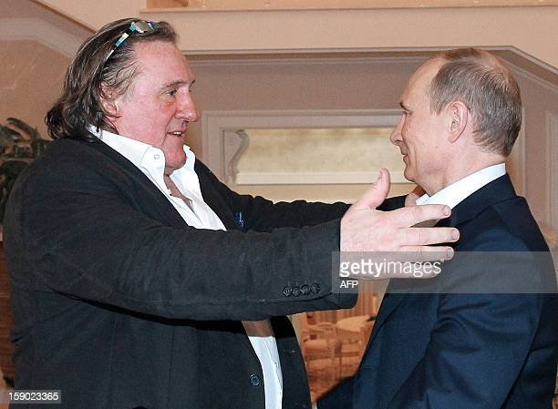 Russian President Vladimir Putin greets French actor Gerard Depardieu during their meeting in Putin's residence in Sochi on January 5 2013 Putin...