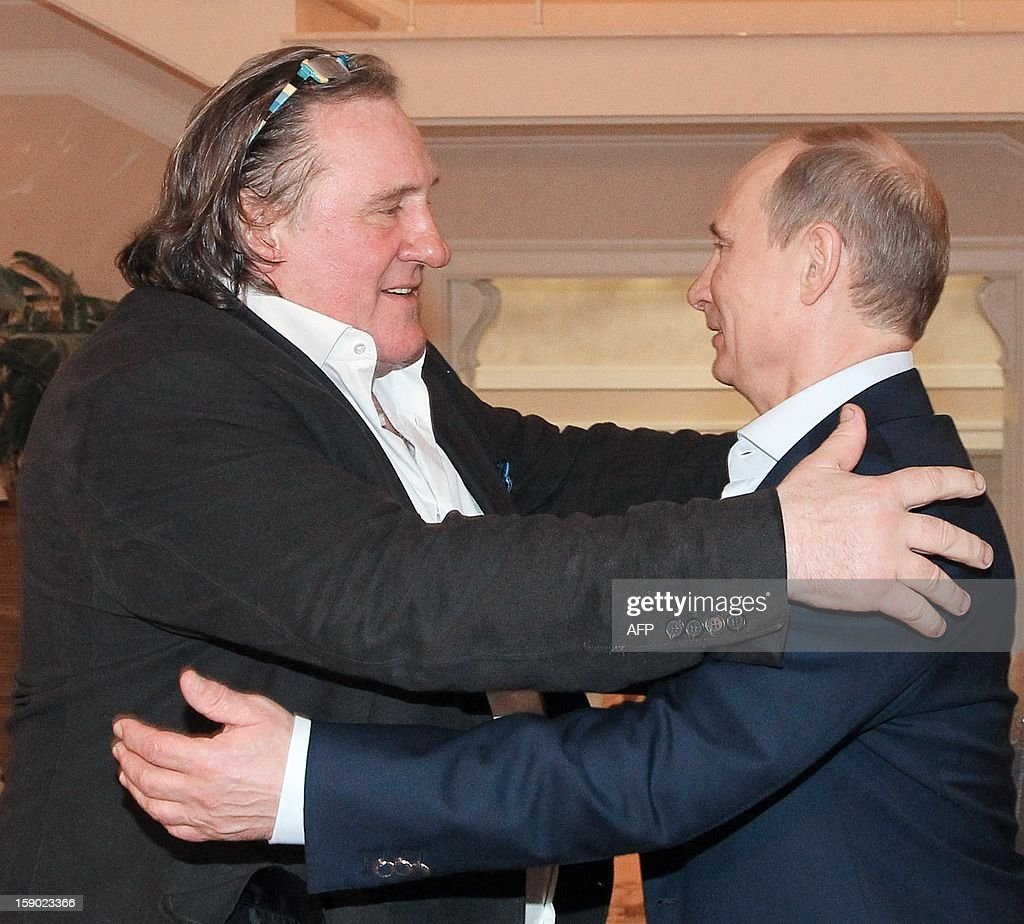 Russian President Vladimir Putin (R) greets French actor Gerard Depardieu during their meeting in Putin's residence in Sochi on January 5, 2013. Putin earlier granted citizenship to Depardieu after the French movie star said he was quitting his homeland to avoid paying a new millionaires' tax. AFP PHOTO/ RIA-NOVOSTI/ MIKHAIL KLIMENTYEV