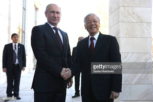 Russian President Vladimir Putin greets General Secretary of Vienam's Communist Party Nguyen Phu Trong on November 25 2014 in Sochi Russia Leader of...