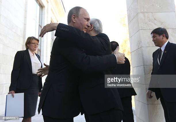 Russian President Vladimir Putin greets General Secretary of Vienam's Communist Party Nguyen Phu Trong on November 25 2014 in Sochi Russia Leader of...