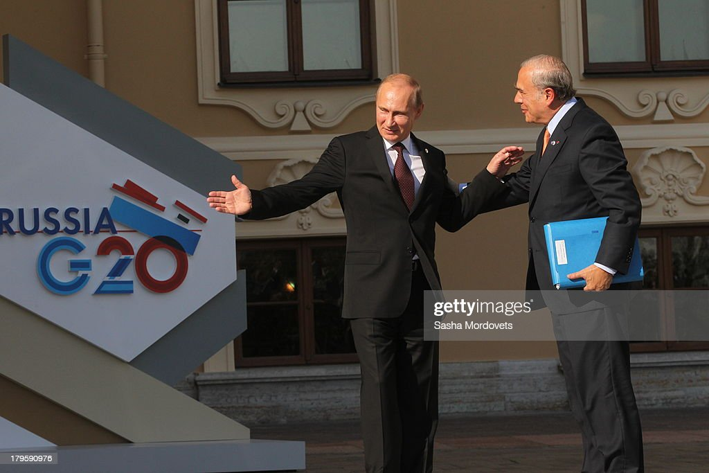 Russian President <a gi-track='captionPersonalityLinkClicked' href=/galleries/search?phrase=Vladimir+Putin&family=editorial&specificpeople=154896 ng-click='$event.stopPropagation()'>Vladimir Putin</a> (L) greets Greek President Karlos Papoulias during the G20 summit on September 5, 2013 in St. Petersburg, Russia. The G20 summit is expected to be dominated by the issue of military action in Syria while issues surrounding the global economy, including tax avoidance by multinationals, will also be discussed during the two-day summit.