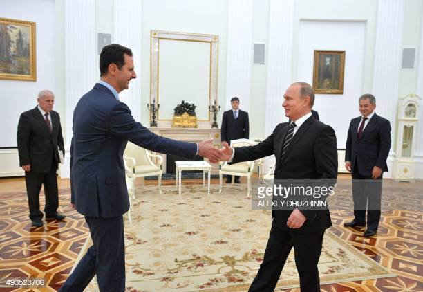 Russian President Vladimir Putin greets his Syrian counterpart Bashar alAssad during a meeting at the Kremlin in Moscow on October 20 2015 Assad on...