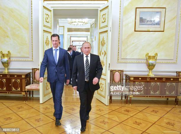 Russian President Vladimir Putin greets his Syrian counterpart Bashar alAssad upon his arrival for a meeting at the Kremlin in Moscow on October 20...